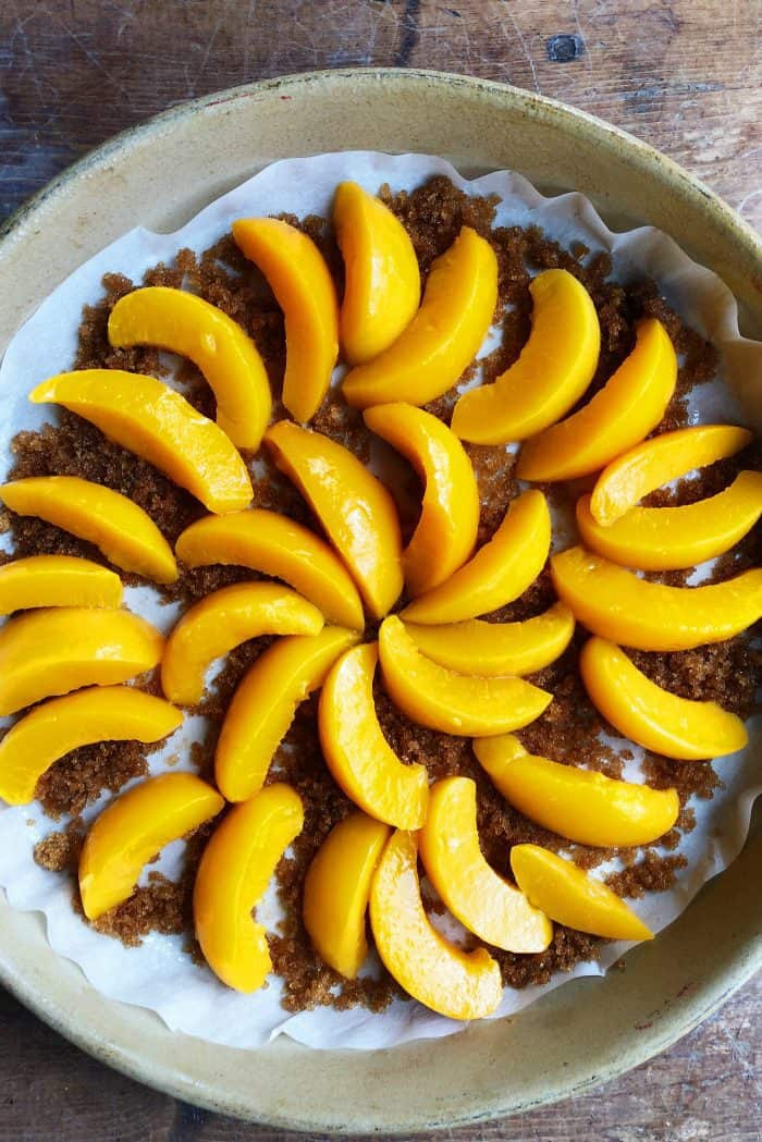 Making Peach Upside Down Cake - making it