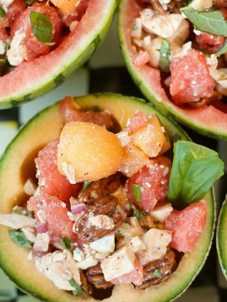 half melon scooped out and filled with chicken melon salad