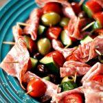 cherry tomato half, salami piece, olive, and cucumber chunk kebab