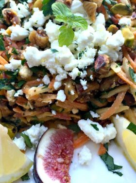 Delicious carrots, figs, goat cheese, herbs - a beautiful presentation for this Carrot Honey Pistachio Salad