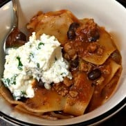 Turkey Lasagna Soup, a delicious winter soup, served with a fresh ricotta cheese mixture on top.