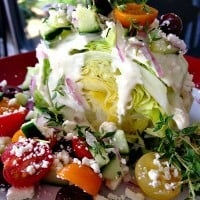 Greek Wedge Salad is an easy, fun, luncheon dish to serve with fresh ingredients!