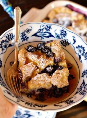 Blueberry Salted Caramel French Toast Casserole for breakfast, brunch, or even dessert, served warm with vanilla ice cream!