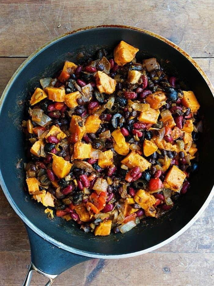 Vegetarian Sweet Potato Bean Enchiladas with olives