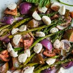 Pesto Asparagus Caprese Salad Recipe with mozzarella cheese, red onions, and tomatoes