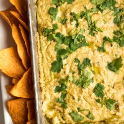 pan of Corn Queso Dip garnished with fresh cilantro