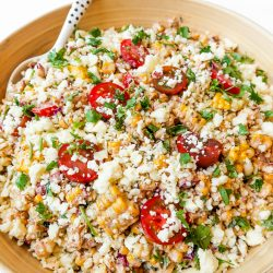 wood bowl with summer corn tomatoe salad