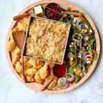 round dinner board with turkey tetrazzini